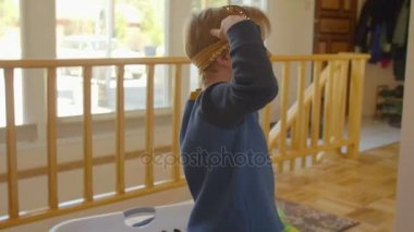 Little boy playing with head bandage