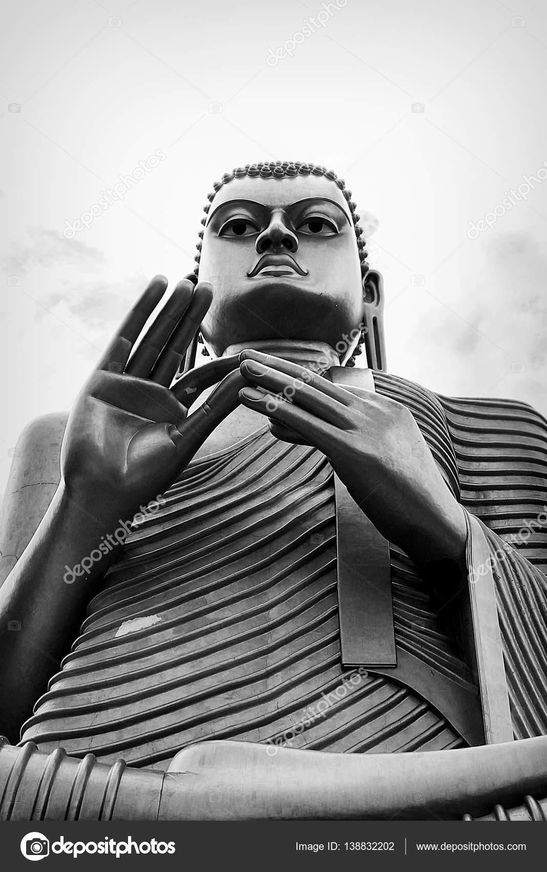 Buddha statue at dambulla cave golden temple sri lanka black and white photo