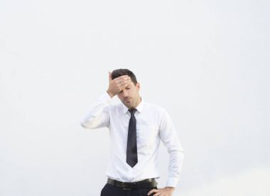 Business man have an headace due to some problems. Stock image