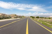 Road in summer mountains valley Cappadocia Turkey.