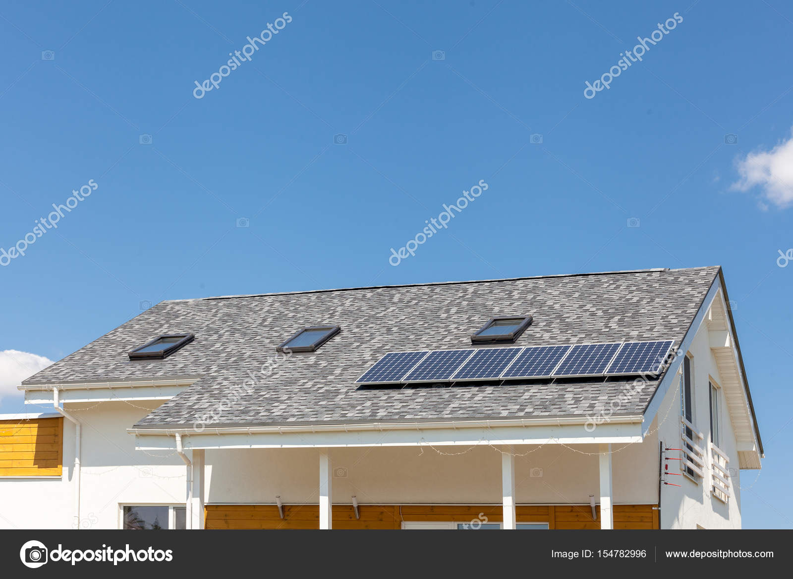 Solar Water Panel Heating On New House Roof With Skylights Against Blue  Sky. U2014 Stock