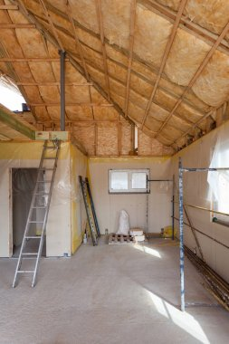 A room at a newly constructed home is sprayed with liquid insulating foam.