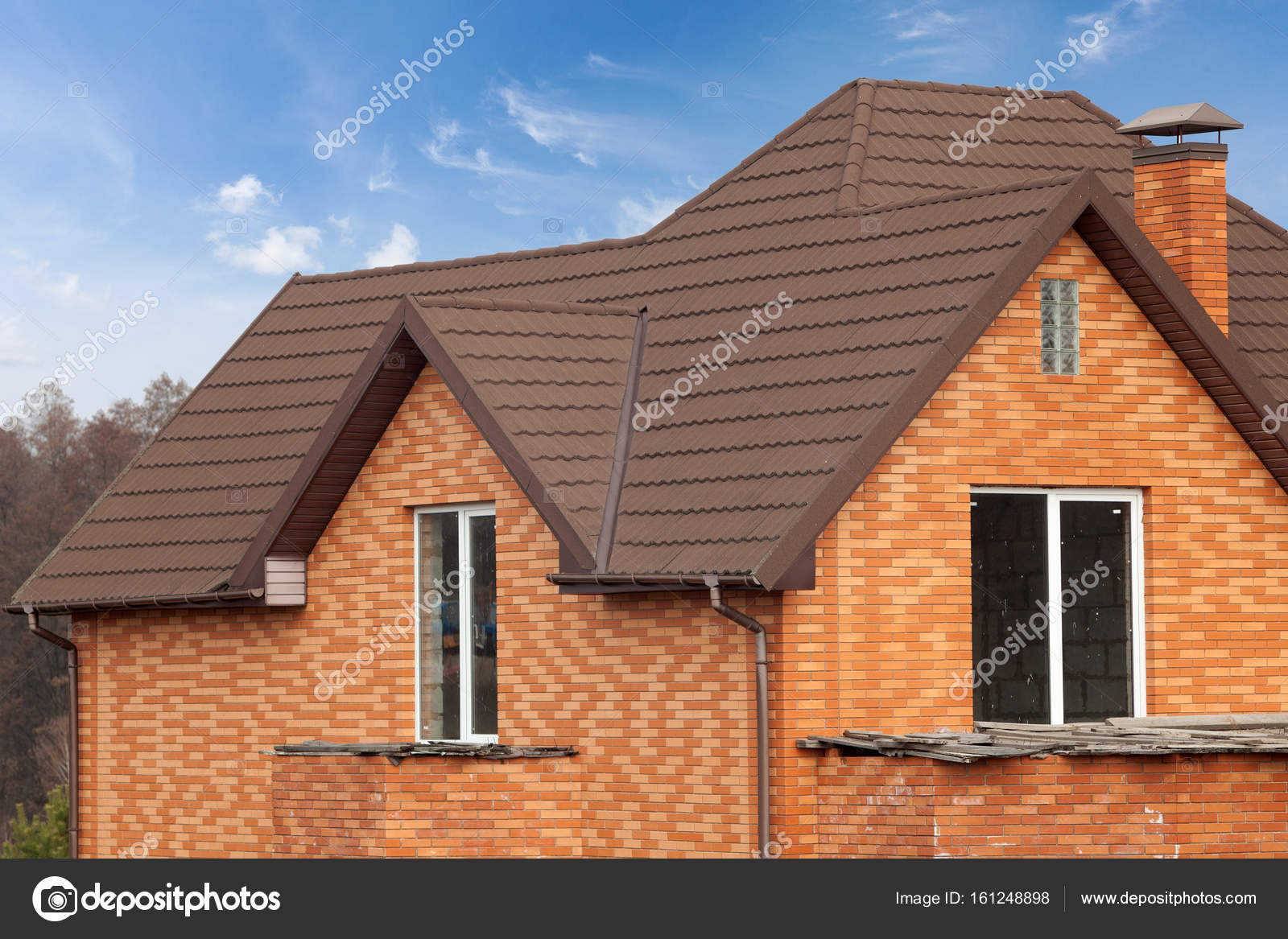 New brick house with modular chimney stone coated metal for Metal roof pictures brick house