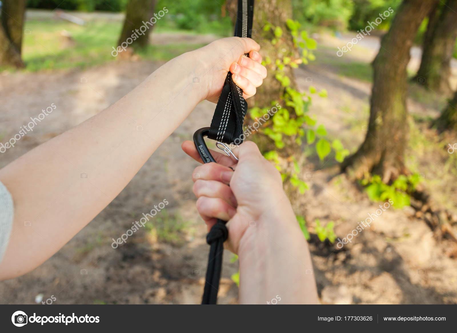 closeup woman hands attach hammock straps tree  u2014 stock photo closeup woman hands attach hammock straps tree  u2014 stock photo      rh   depositphotos