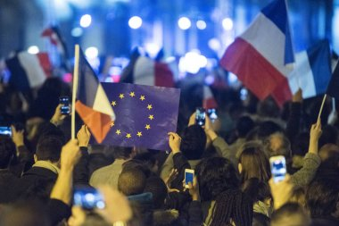 EU flags and France flags shown on a demonstration in Paris.