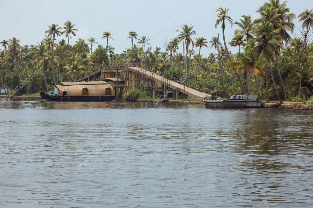 Housboat passing under a bridge