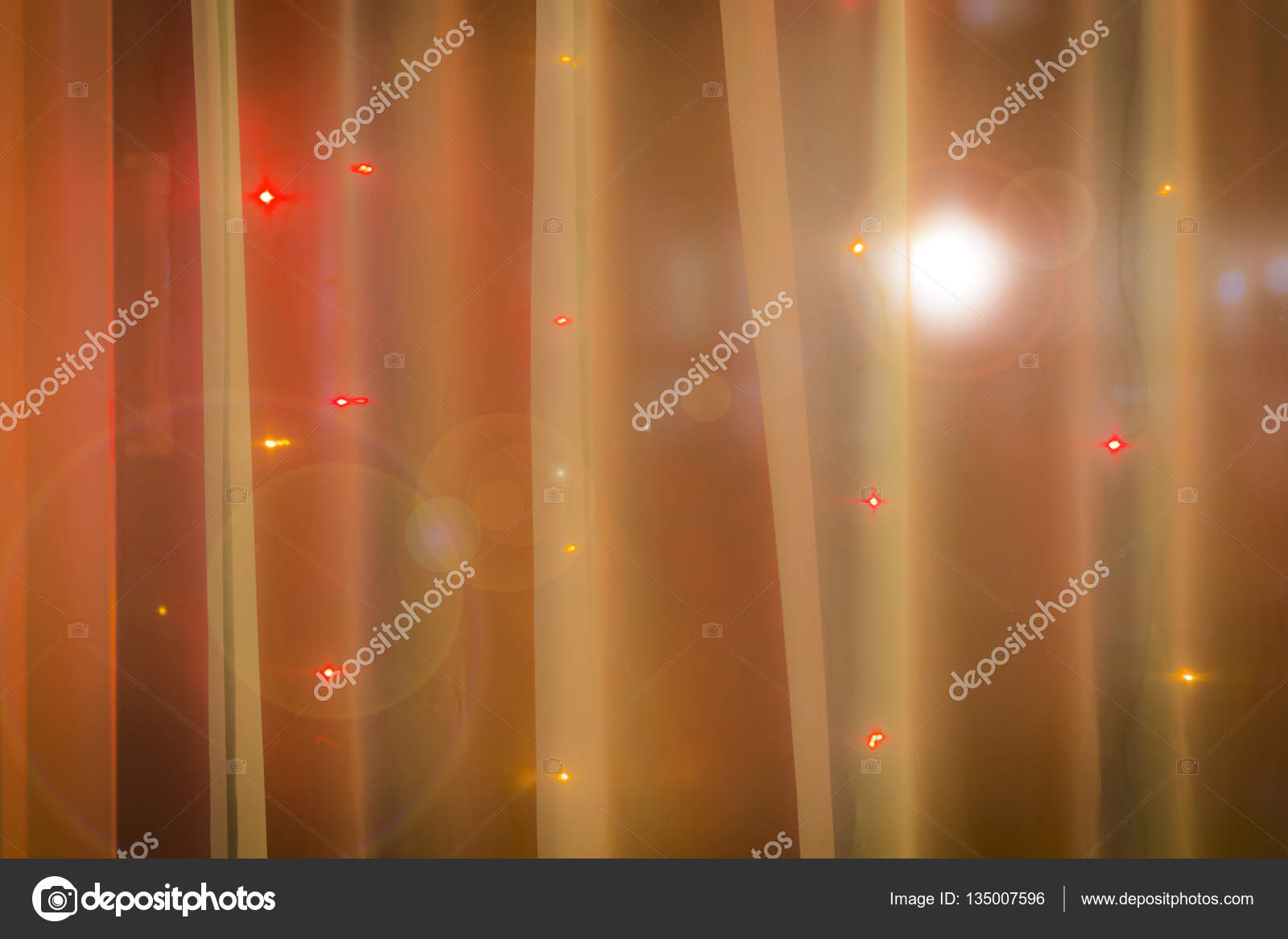 christmas lights in the window on the background of transparent tulle photo by sv_production