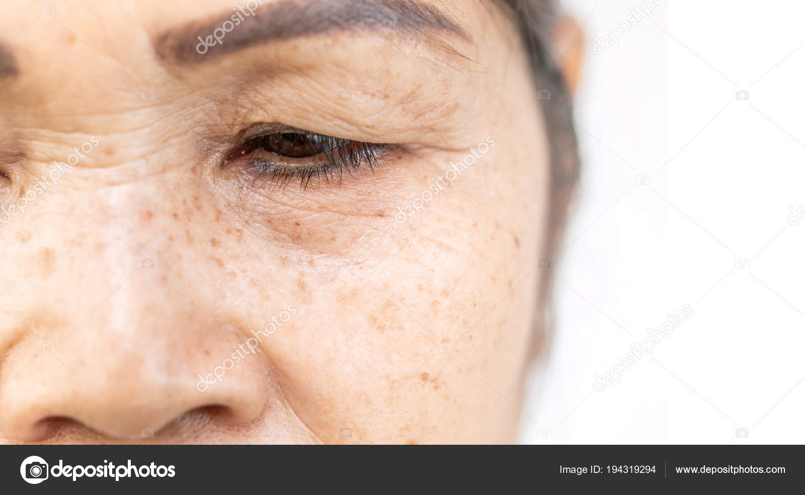 df8f7125dff Wrinkled and lines of old asian woman eyelid skin texture in closeup  selective focus — Photo by ...