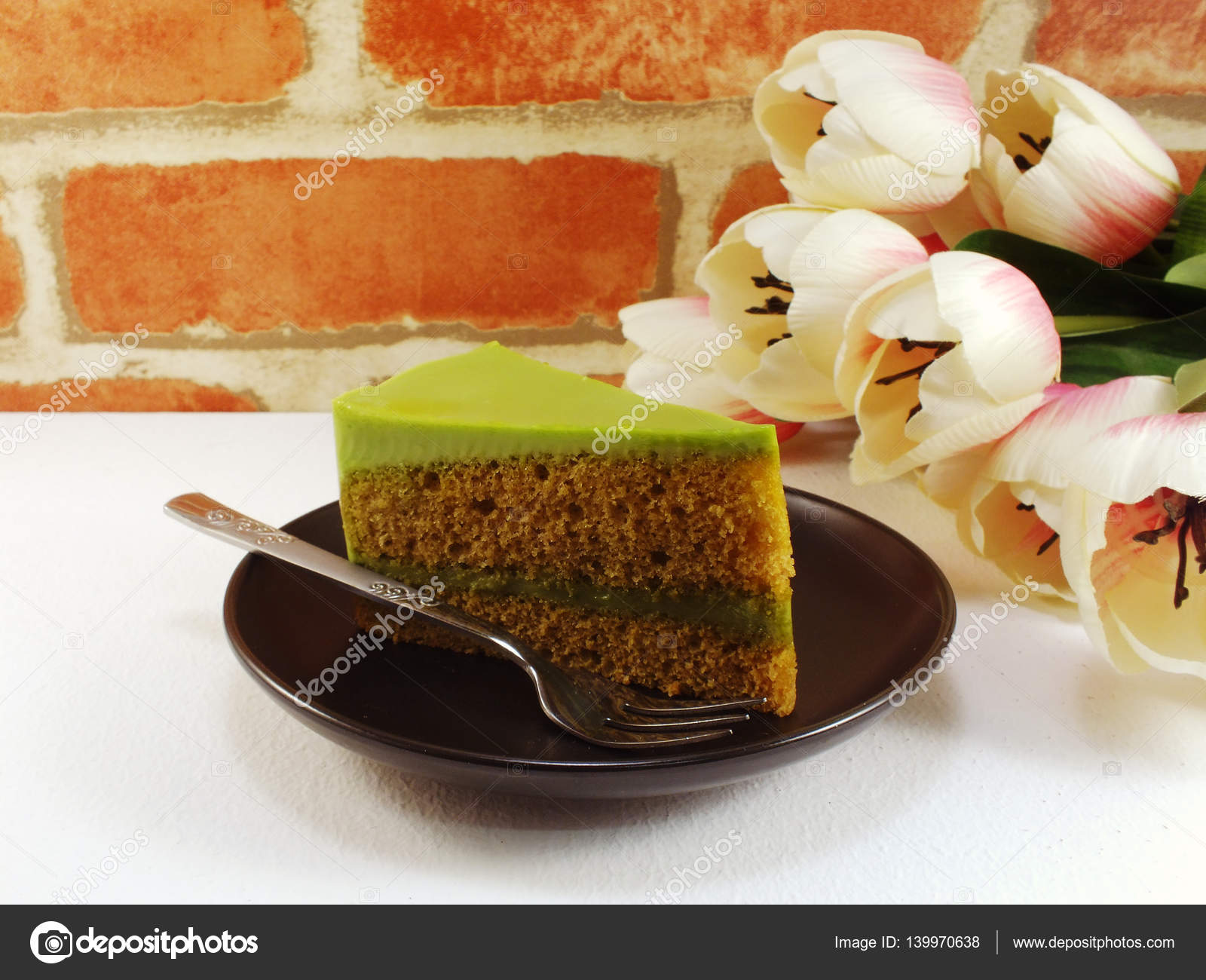 Homemade Green Tea Cake On Dish With Spring Flower And Space Copy