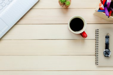 office desk  notebook,pencil,black coffee,cactus, watch,Laptop.