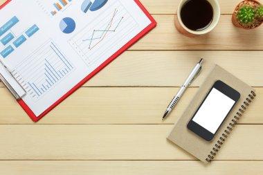 office desk chartered sheet,pen,coffee,smartphone notebook,cactus.