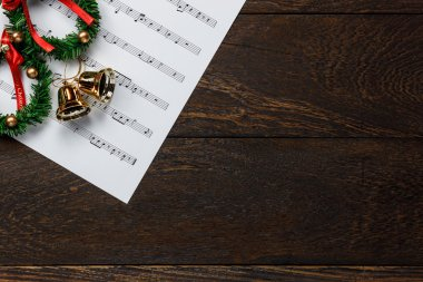 Top view Christmas music note paper  with Christmas wreath.