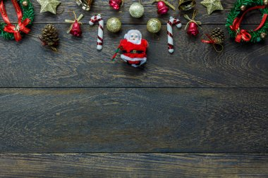 Top view Christmas decoration and Santa Claus doll on wooden bac
