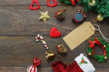 Top view greeting card with Christmas decoration on wooden table