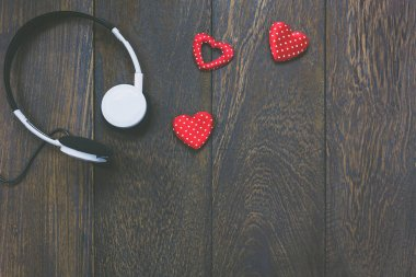 Top view music with valentines day background.Headphones.