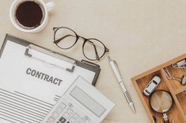 Top view business contract form with coffee eyeglasses.