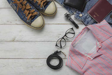 Above view of fashion women clothing for travel concept background.