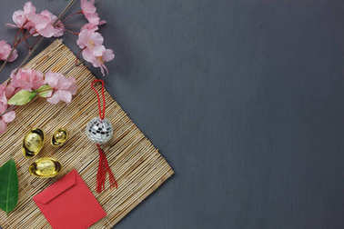 Overhead  of top the important ornaments items for Happy Chinese new year background concept.Essential accessory for the festival.Mix several necessary object on grunge grey wooden home office desk