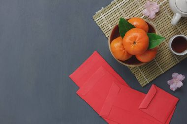Overhead view of items for Chinese & Lunar Happy New Year concept background.Different essential accessory on modern rustic table home decoration.Mix objects and oranges for the festival season.