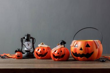 Essential accessory of Happy Halloween decorations festival concept background.Mix variety items on modern rustic brown wooden at home office studio desk.Blur orange space for creative design wording.