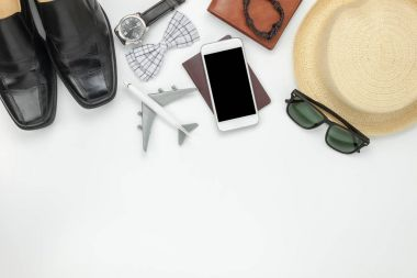 Above view of accessory travel and fashion men or technology concept background.