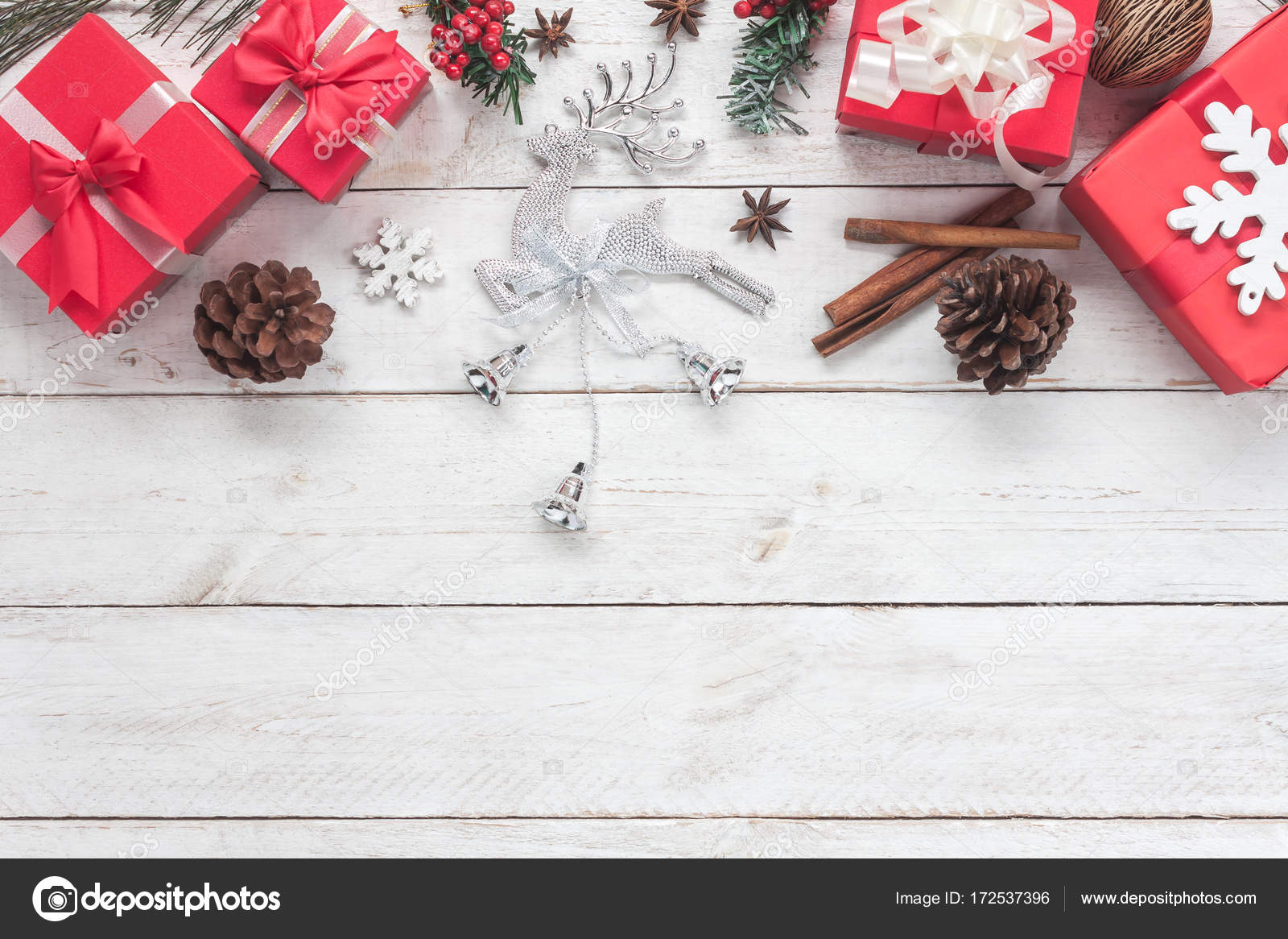 above view of merry christmas decorations happy new year ornaments conceptessential difference objects on modern rustic wood white background at home - Essential Christmas Decorations
