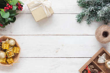 Top view aerial image of decoration & ornament merry Christmas & Happy new year background concept.Essential accessories on vintage grunge white wood at home office desk.free space for creative design