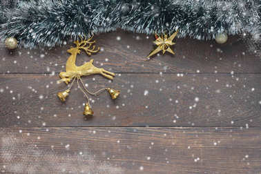 Above view image of beautiful gold reindeer decoration merry Christmas & Happy new year concept background.Accessories object on vintage grunge wooden at home office desk.free space for text & font.