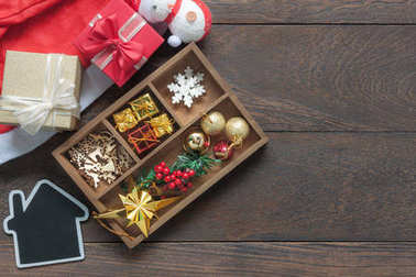 Flat lay aerial image of accessories Merry Christmas & Happy new year festival background concept. Variety beautiful decoration for the winter season on vintage grunge wooden at home office desk.