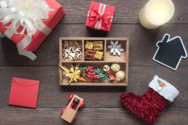 Top view aerial image of ornaments & decorations festive merry Christmas & Happy new year background concept.Many difference accessories on modern brown rustic wood at home office desk studio.