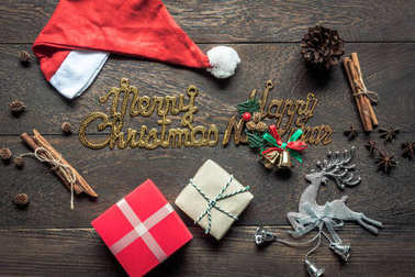 Overhead view of image decorations & ornaments merry Christmas & Happy new year background concept.All accessories on vintage rustic brown wooden at home office desk studio.items for winter season.