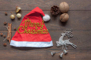 Flat lay aerial image of ornaments & decorations merry Christmas & Happy new year background concept.Beautiful essential item on vintage grunge brown wooden at office table studio.free space for text