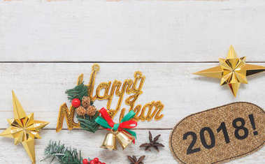 Overhead view aerial image of close up homemade happy new year 2018 ornament & decoration home party decor background concept.Table top accessories on vintage grunge white wooden at office desk studio