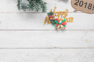 Overhead view aerial image of decorations & ornaments Happy new year concept.Items for home party holidays decor.Objects on vintage grunge white wooden at office desk or table studio background.