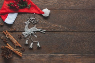 Table top view aerial image of items decor Merry Christmas & Happy new year background concept.Beautiful decorations  on modern rustic brown wooden at home office desk.Free space for creative text.