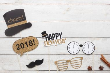 Above view aerial image of DIY photo booth props decorations Happy new year 2018 Home party decor background concept.Table top item on modern rustic white wood at home office desk studio & copy space.