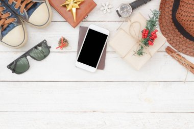 Above view of image items to travel with decorations Merry Christmas & Happy New Year background concept.many essential objects on modern rustic white wooden at home office.accessory for traveler.