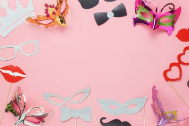 Table top view aerial image of beautiful carnival party mask or