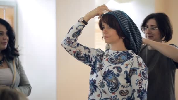 Stylist Shows On Model How To Tie Scarf On Your Head Stock Video