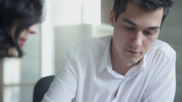 Boss man explains work plans for employees inside office