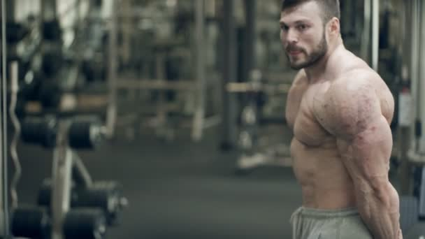 Male athlete posing standing in gym indoors.