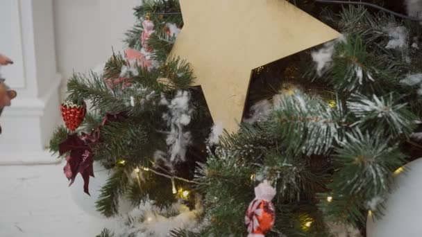 Christmas Tree Spray Snow.Hands Hold Can And Spray Artificial Snow On Branches Of Christmas Tree