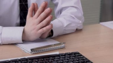 Close up of male hands on table at business negotiations in the office, slow motion.