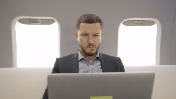 Portrait of male chief banker director broker nervously observing trades and enjoying his win in private plane.