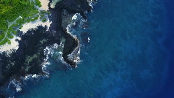 Top aerial view to the blue lagoon on the beach of Hawaiian coastline. USA