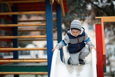Child climbing the slide