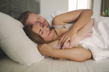 Romantic relaxed couple in bed