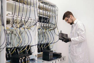 Network technician testing modems