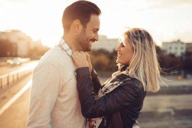 Woman buttoning boyfriends shirt in sunset stock vector