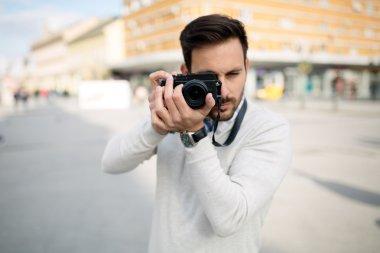 Photographer tourist taking photos outside